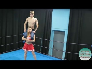 strong girlfriend lift carry weak boyfriend in wrestling ring