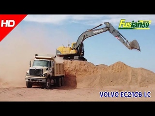 Volvo EC210B Lc Excavators Dig Ground And Load Into The Dump Truck