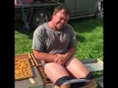 Bee Keeper Sits On Bee Hive for money