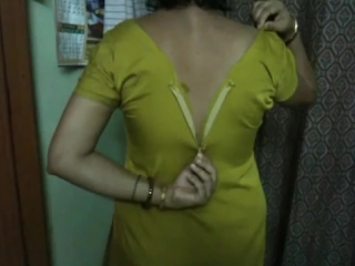 Indian aunty taking her shirt off in bedroom