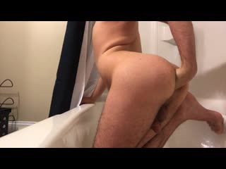 Filthy slut fisting in the tub