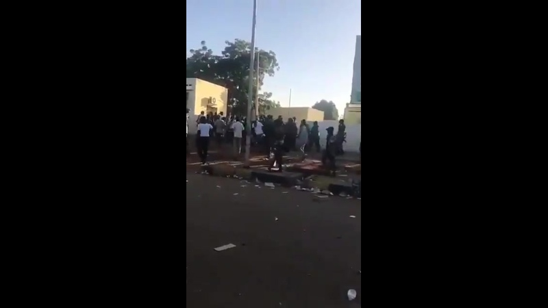 Members of Sudanese National Intelligence and Security Service dressed in Army fatigue using brute force on those cought